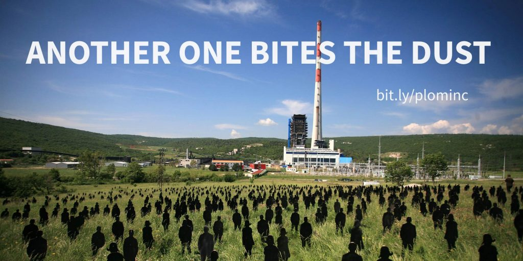 Black silhouettes stand on the grass in front of a coal power plant.