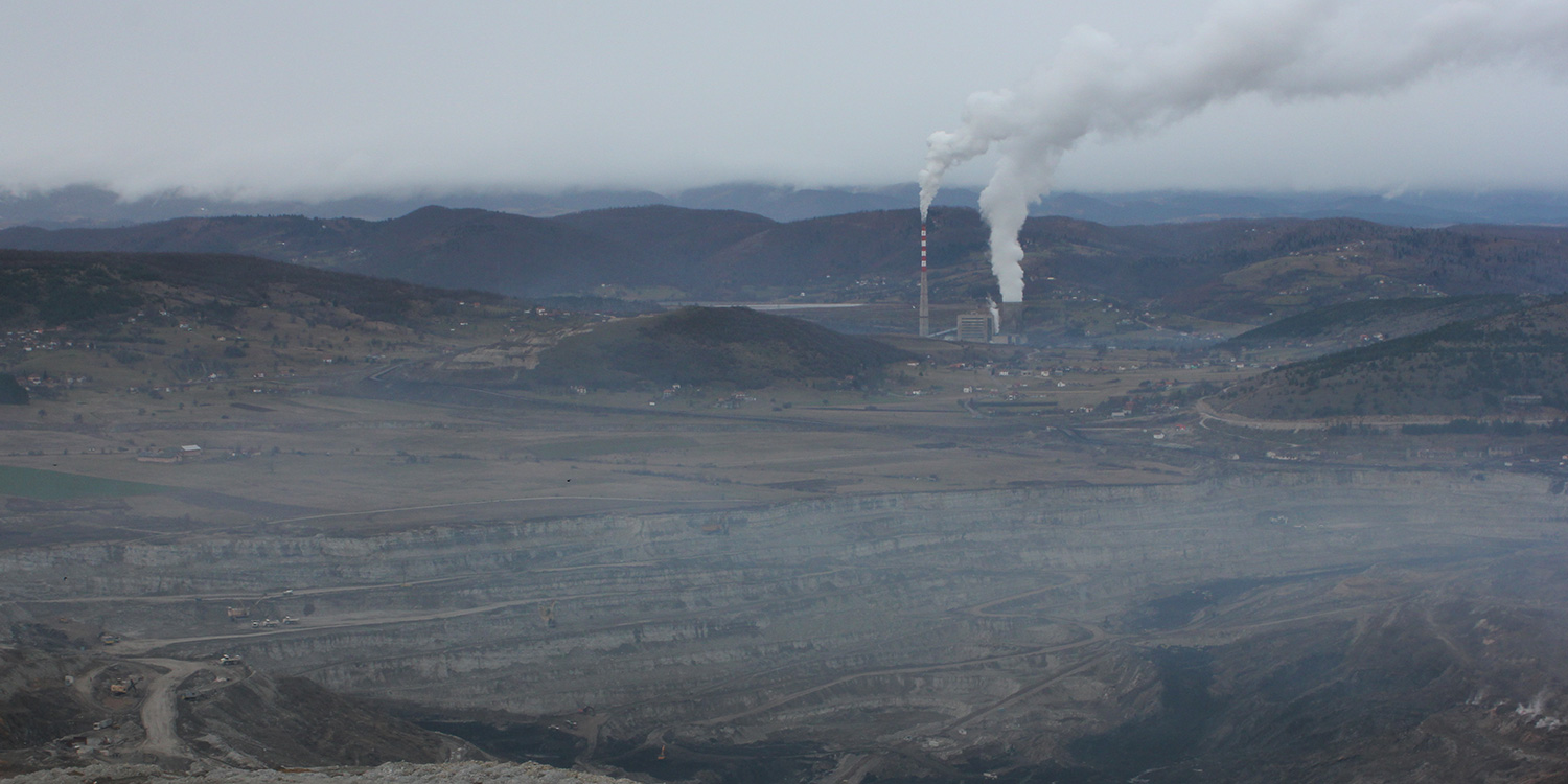 The Pljevlja power plant in Montenegro and the mine in front. Both are submerged in smog.