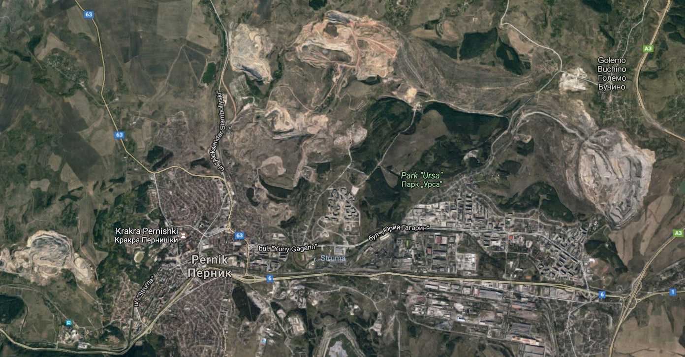 A satellite image of Pernik. The lignite mining pits are almost as big as the town itself.