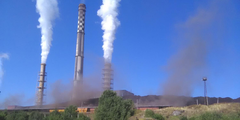 Smoke stacks of the Bobov Dol power plant spewing black and white smoke.