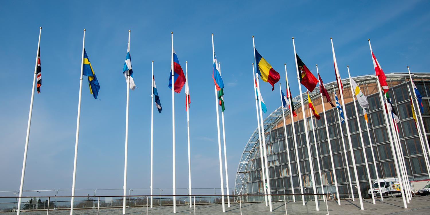 Flags of EU coutries in front of the EIB headquarter building.