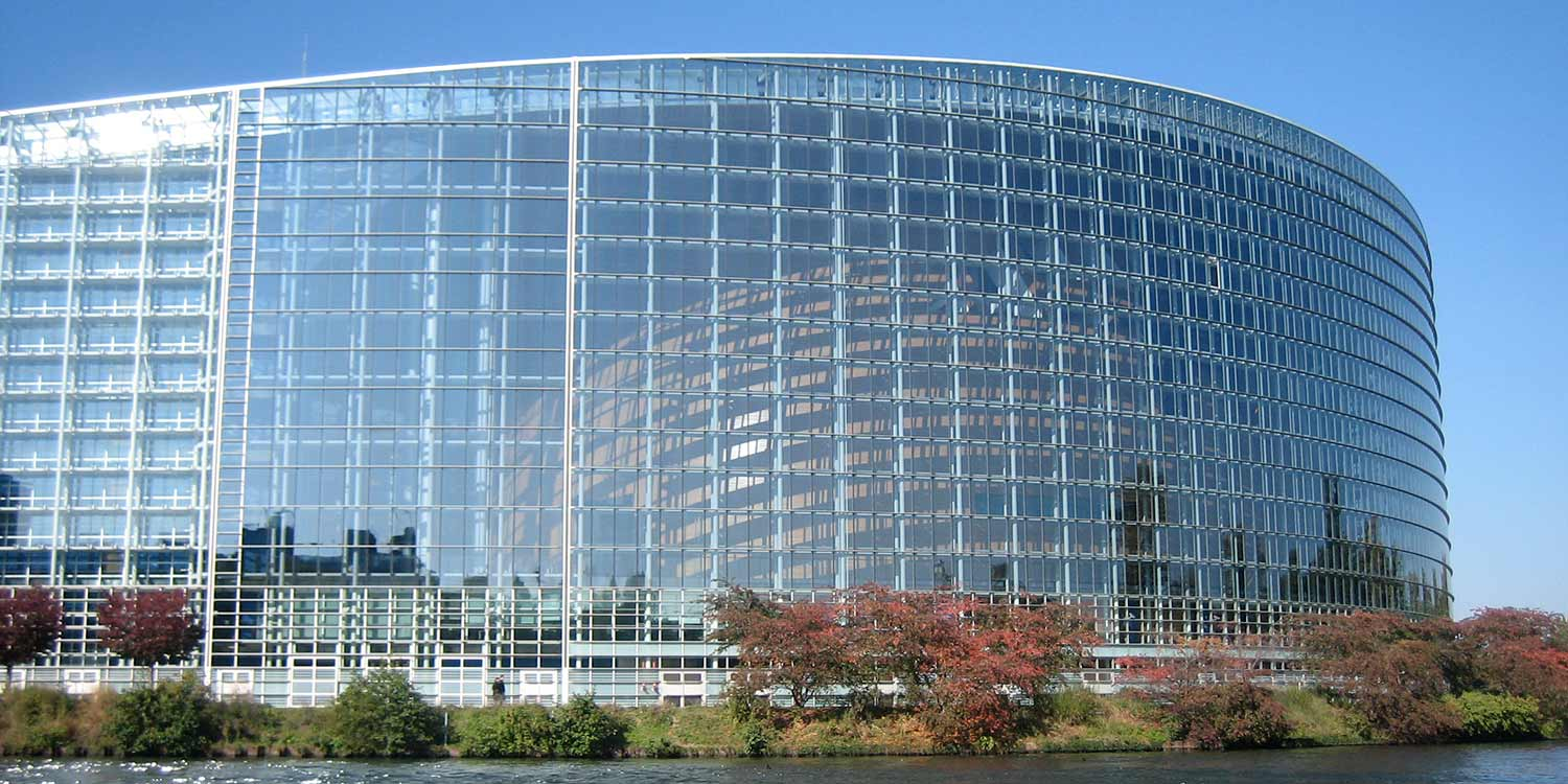 The EU Parliament building Strasbourg, a modern office building at a water front.