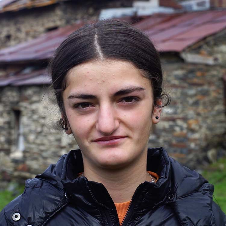 A Georgian girl looking and slightly smiling into the camera.