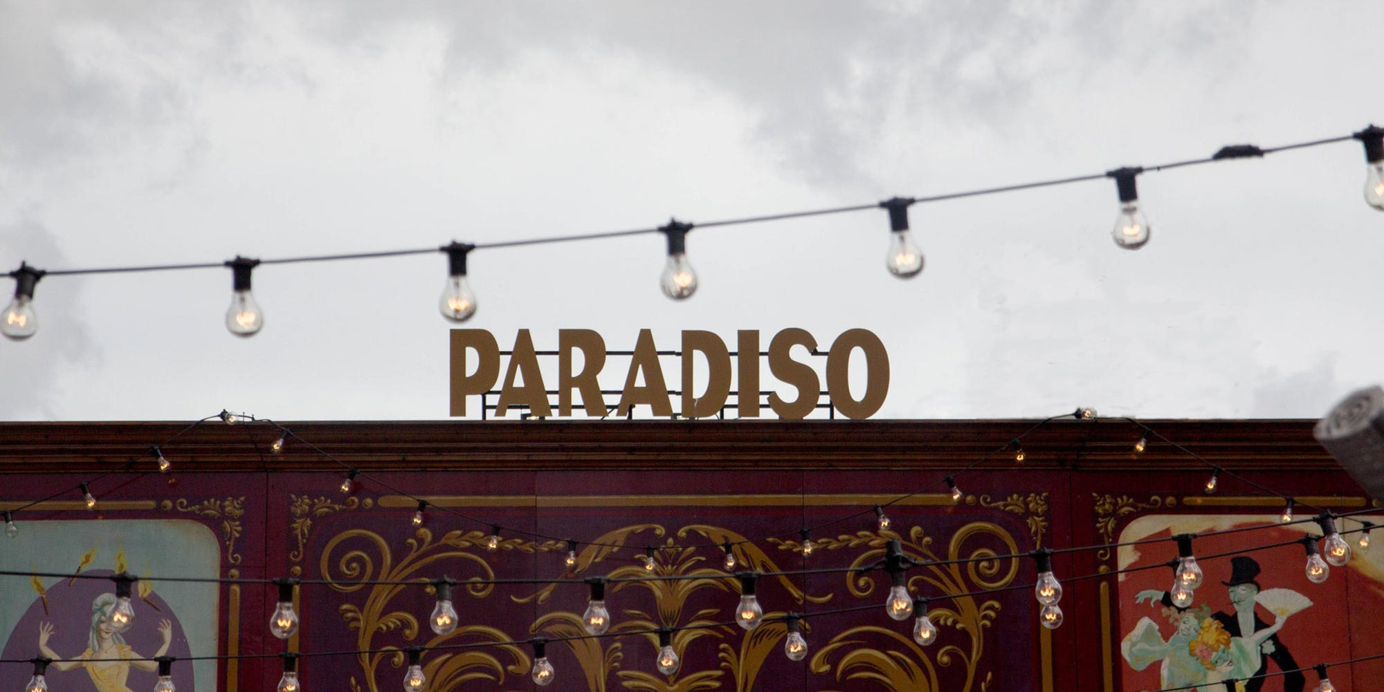 """Paradiso"" in large letters against a grey sky."