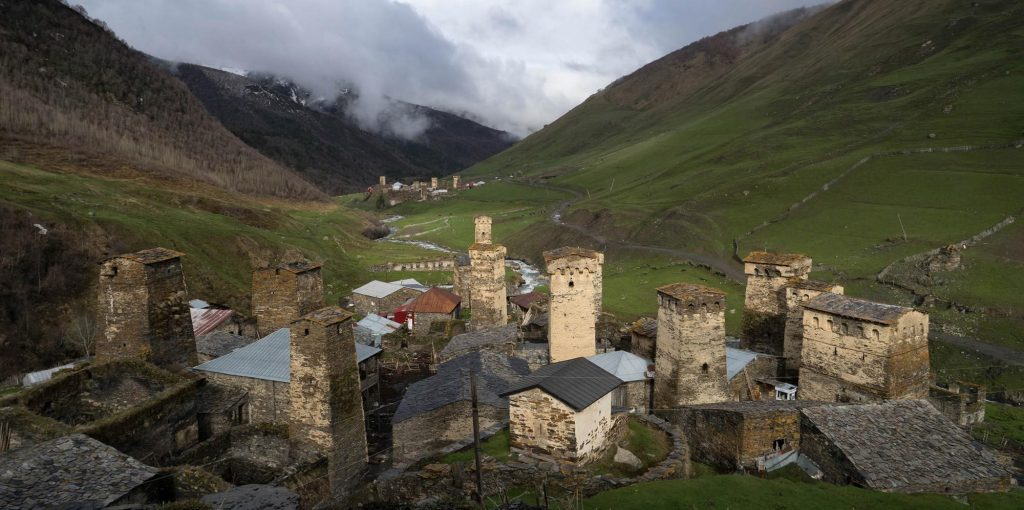 A panorama view of Ushguli and it's medieval houses in Georgia's caucasus mountains.