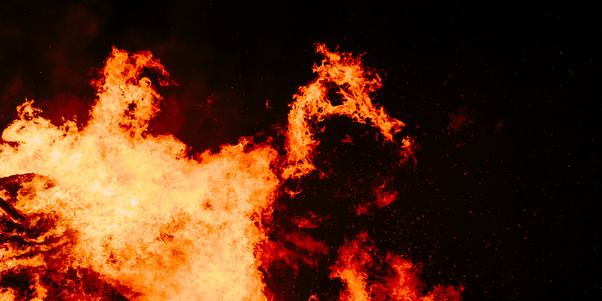 A photograph of a fire against a black background.