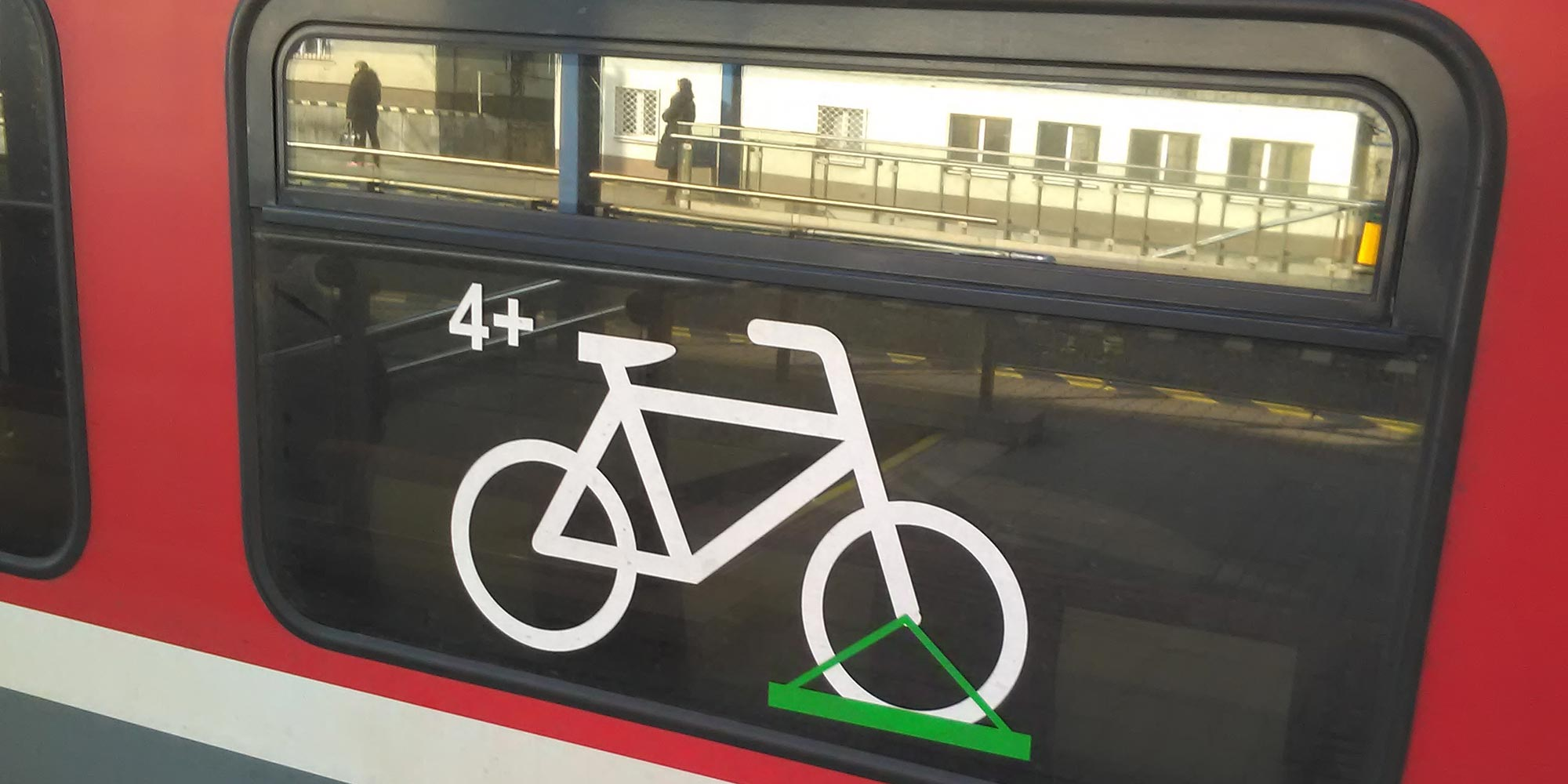 Image: A sign on a train window shows that bike racks are available for commuters.
